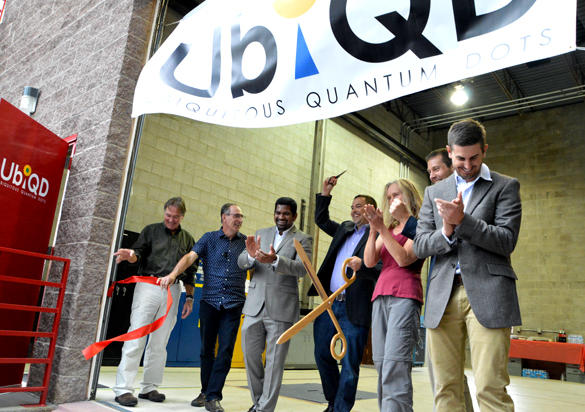 UbiQD Chairman of the Board, Founder and President Hunter McDaniel, center, with colleagues cuts the ribbon at the grand opening of UbiQD during Friday's windy afternoon at 134 Eastgate Dr. Photo by Carol A. Clark.